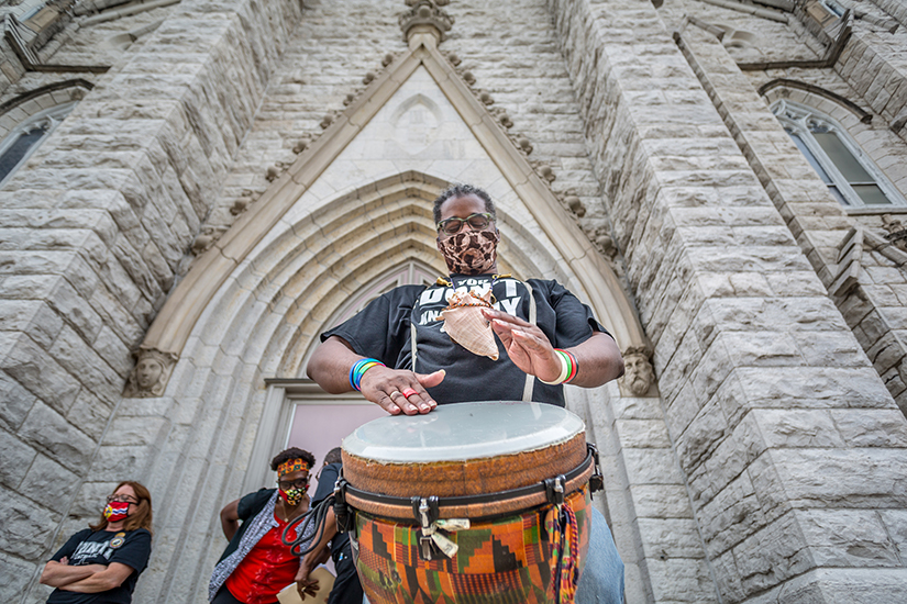 "David A.N. Jackson played a djembe drum at the racial harmony vigil at St. Alphonsus Liguori ""Rock"" Church June 27."