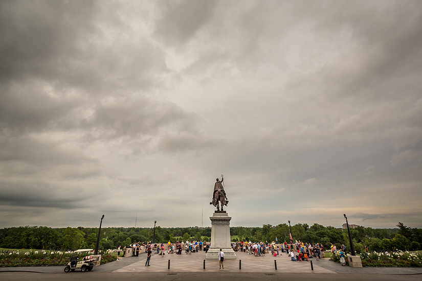 Catholics prayed at the Apotheosis of Saint Louis statue in Forest Park on July 1.