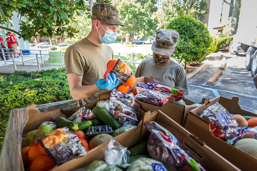 Specialists Jason Arden and Saricia Murrey of the Missouri National Guard stocked perishables as Catholic Charities distributed food and personal care items at Catholic Charities headquarters in St. Louis on July 24. Nearly 500 households were assisted during the distribution.