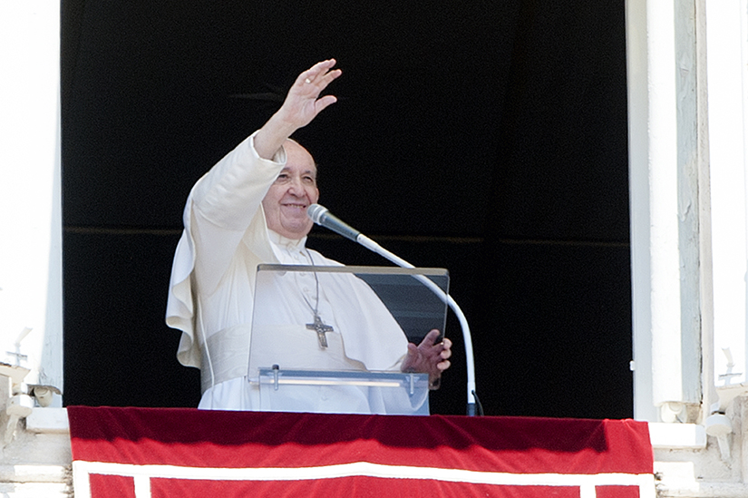 Pope Francis waved to the crowd in St. Peter's Square from a window of the Apostolic Palace at the Vatican during his Angelus address July 26. Following the address, he urged young people to show grandparents and the elderly tenderness.