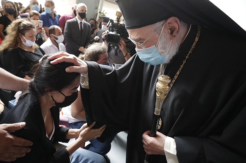 Metropolitan Elias Audi, bishop of the Greek Orthodox Church of Antioch for the Archdiocese of Beirut, offered condolences to families of four nurses of the Saint George Hospital University Medical Center who died in the Tuesday explosion at the seaport of Beirut, during a mass in Beirut, Lebanon, on Aug. 6.