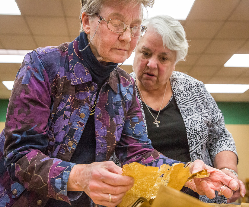 Sister Jane Behlmann, CSJ, archivist for the Sisters of St. Joseph of Carondelet, and Sister Marilyn Lott, CSJ, read a letter written by a member of her order explaining the sister's history in coming from France to St. Louis to teach the deaf. The letter was found in a time capsule that was opened on March 28.