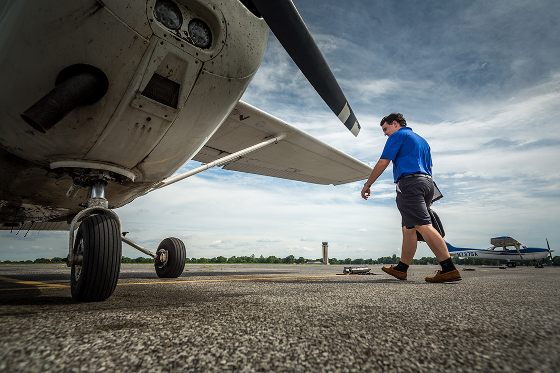 Pilot John Cosgrove walked toward his aircraft before flying out of St. Louis Downtown Airport in Cahokia, Ill. John sees his work as a pilot as connecting people with each other, in addition to connecting with Jesus.