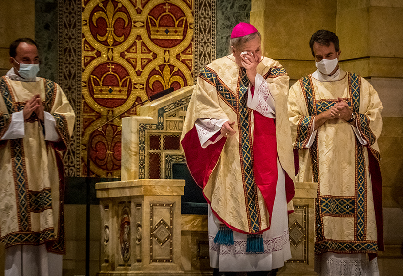 Archbishop Robert J. Carlson wiped his face at a Mass of Thanksgiving Aug. 23 at the Cathedral Basilica of Saint Louis. In the homily, Archbishop Carlson shared some of the ways he's felt blessed during his time as Archbishop of St. Louis.