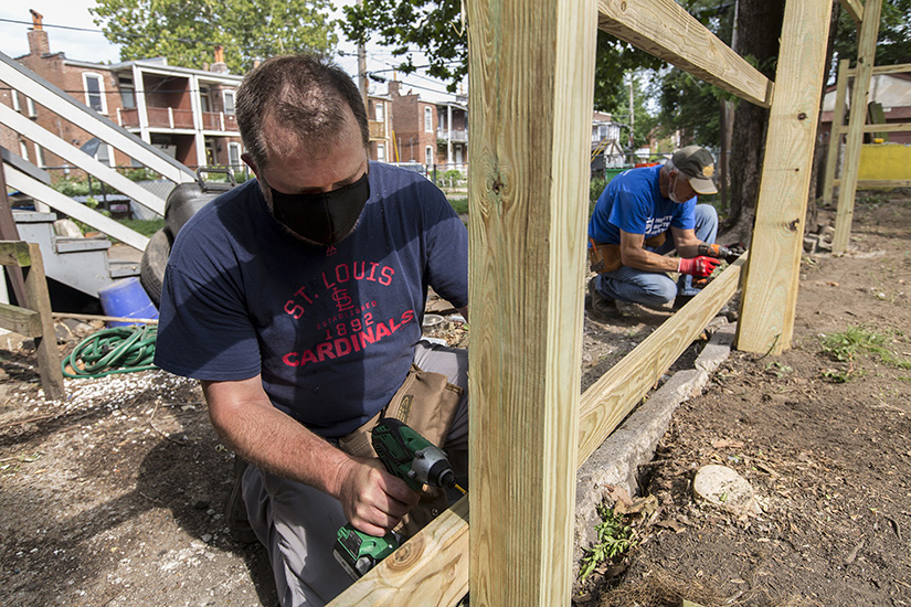 Gary Nipper, left, with St. Stephen the Protomartyr Parish's Holy Name Society, and Ron Decker with First Presbyterian Church of Kirkwood, joined other workers organized by St. Joseph Housing Initiative to construct a backyard fence Saturday at a house in the Dutchtown neighborhood of St. Louis on Aug. 29.