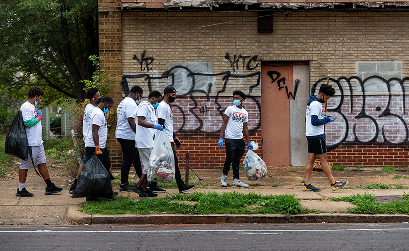 Students from Cardinal Ritter College Prep carried bags of trash they had collected along North Grand Boulevard Sept. 12. Students from Cardinal Ritter joined Operation Clean Sweep to clean up a more than two-mile stretch of North Grand Boulevard.