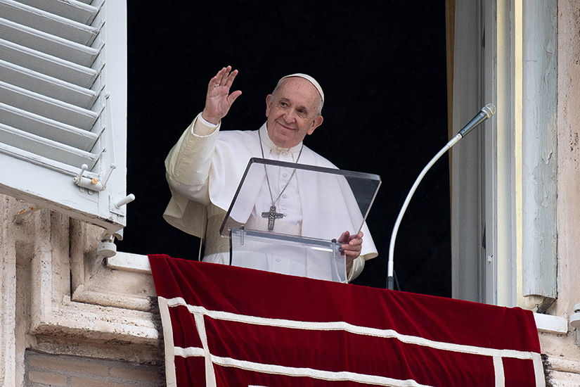 Pope Francis greeted the crowd as he led the Angelus from the window of his studio overlooking St. Peter's Square at the Vatican Oct. 11.