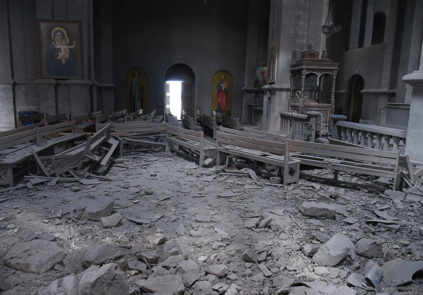 Damaged pews lay amid rubble inside Holy Savior Cathedral in Shusha, Azerbaijan, Oct. 8, after shelling during a military conflict. Armenian Archbishop Raphael Minassian is pleading for European help in getting Armenia and Azerbaijan to cease fire in their conflict over Nagorno-Karabakh.