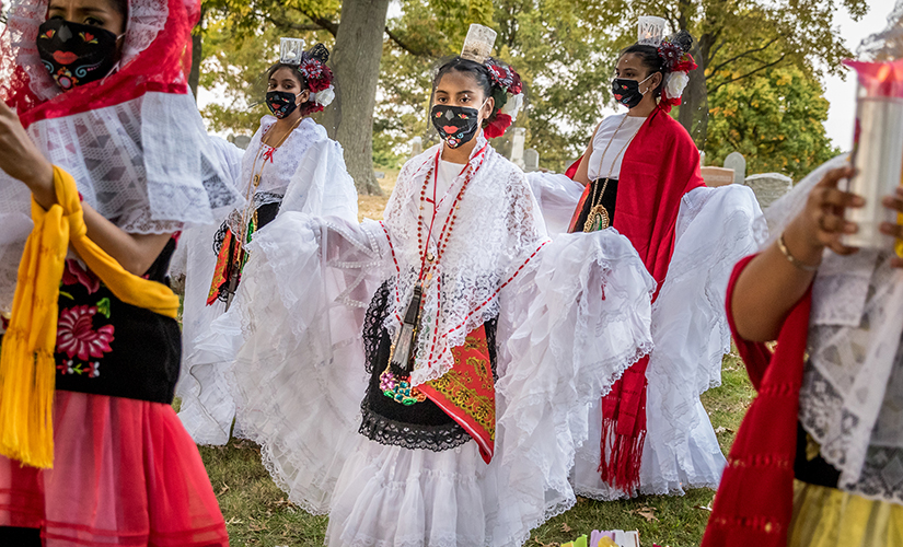 Lizett Mata, Alondra Salis, Yoselin Alvarado, Valeria Salis and Jessica Torres, parishioners at Our Lady of Guadalupe, danced traditional Mexican dances at a Día de Muertos (Day of the Dead) celebration at Sacred Heart Cemetery in Florissant on Oct. 8.