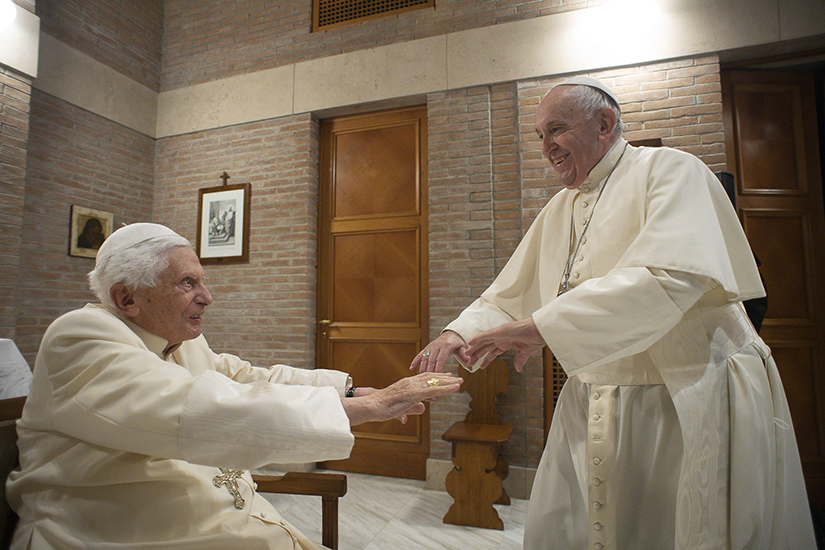 Pope Francis greeted retired Pope Benedict XVI at the retired pope's residence during a visit with new cardinals after a consistory at the Vatican Nov. 28.