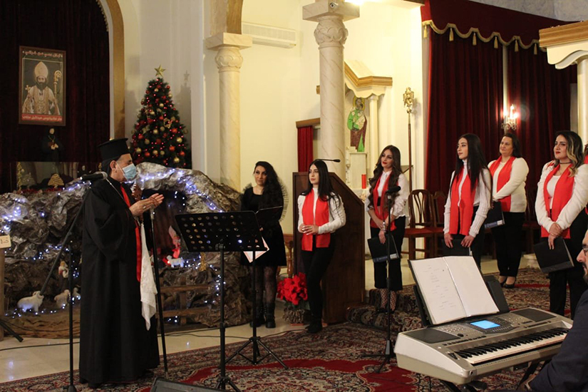 Syriac Catholic Patriarch Ignace Joseph III Younan spoke with the Holy Missionary Choir during a pre-Christmas celebration for Iraqi Syriac Catholic refugee families in Lebanon Dec. 12. The celebration was at Sts. Behnam and Sarah Church in Fanar, Lebanon.