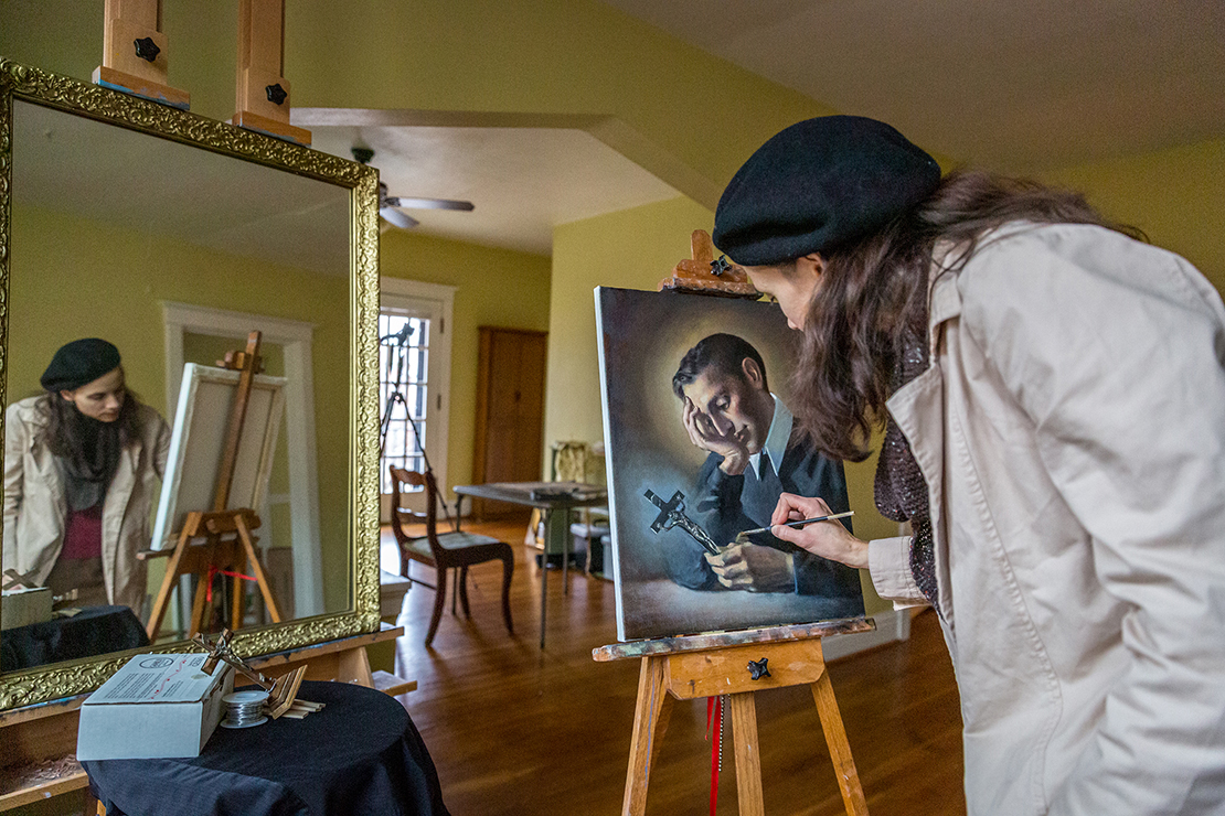 "Gwyneth Thompson-Briggs worked on a painting of St. Gerard Majella in her studio in St. Louis Dec. 12. Thompson-Briggs said that ""we need visible and audible beauty to help us see the glory of God."""