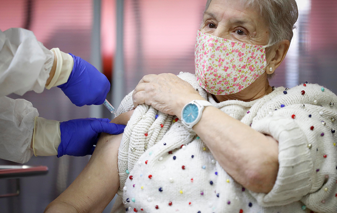 An elderly woman received an injection with a dose of Pfizer-BioNTech COVID-19 vaccine at Vallecas nursing home in Madrid Dec. 27.