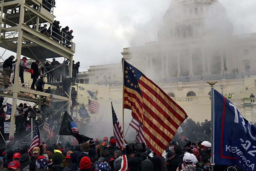 "Supporters of President Donald Trump gathered in front of the U.S. Capitol in Washington Jan. 6. During the day, some people breached the security and entered the Capitol building, forcing a temporary halt to Congress' count of electoral votes. One woman was shot and killed and three other people died of ""medical emergencies."""