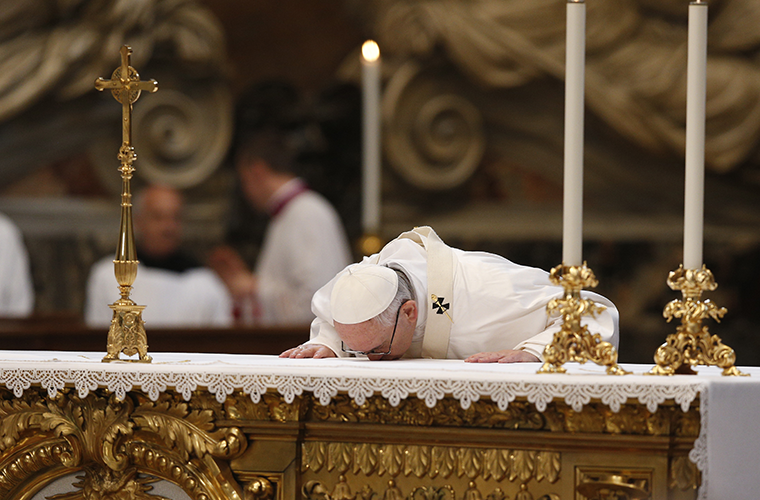 Pope Francis venerated the altar at Mass with hundreds of priests who are missionaries of mercy April 10 in St. Peter's Basilica. The pope has continued the mandate of the missionaries of mercy.