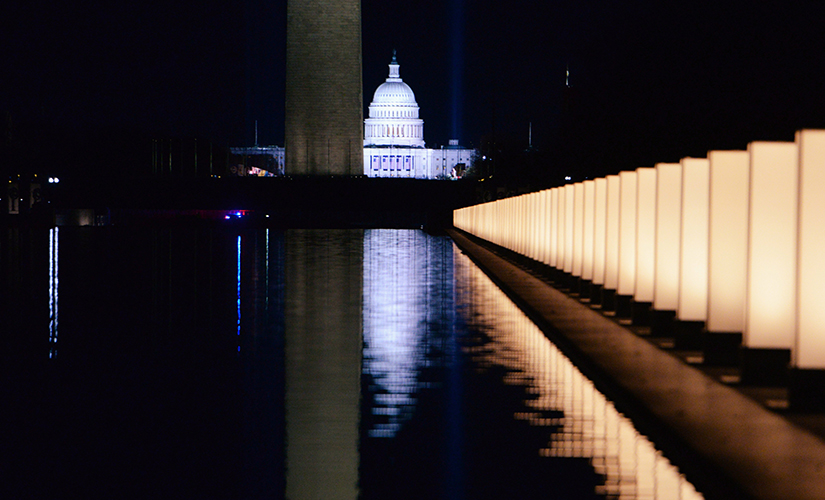 The U.S. Capitol is seen reflected at the reflecting pool at the Lincoln Memorial in Washington Jan. 19 after President-elect Joe Biden hosted a memorial honoring those who died from the coronavirus disease. Cardinal Wilton Gregory of Washington, D.C., prayed at the memorial.