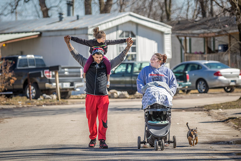 "Dakota and Nicole Roper took a walk with their 6-year-old daughter Sophia, 5-week-old daughter Lakota, and dog Freddie. The Ropers received emotional and moral support from Barb Buhmann, an area life coordinator with the Society of St. Vincent de Paul's new Pregnancy Care Program. ""When I got out of the ICU, (Barb Buhmann) checked on me every day and sent me pictures or Bible verses and stories to try and uplift my spirits,"" Roper said of Buhmann."