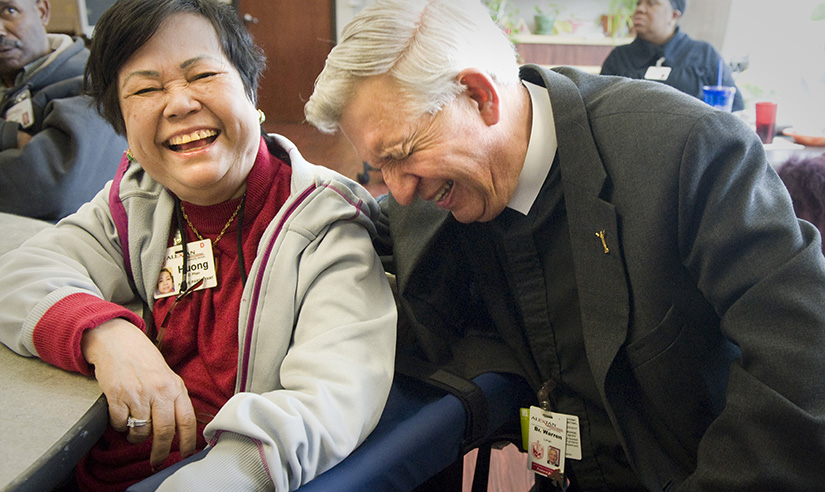 "Brother Warren Longo, CFA, laughed with PACE program participant Huong Phan, who liked to refer to him as ""Mr. Handsome."" Brother Longo served as the pastoral care coordinator of the Alexian Brothers' PACE program in St. Louis, which provided older adults with comprehensive care, allowing them to remain in their homes. The program ended in 2016. After more than 150 years of service in the Archdiocese of St. Louis, the last of the Alexian Brothers left in October for ministries in other parts of the United States. The brothers' mission has been to care for the sick, aged, poor and dying."