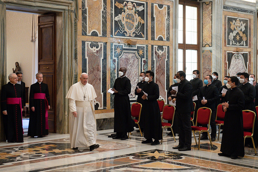 "Pope Francis arrived for an audience with priests studying at the Pontifical Filipino College, at the Vatican March 22. The pope encouraged Filipino priests doing graduate studies in Rome not to think of their time there as a pause disconnected from their ""real"" lives."
