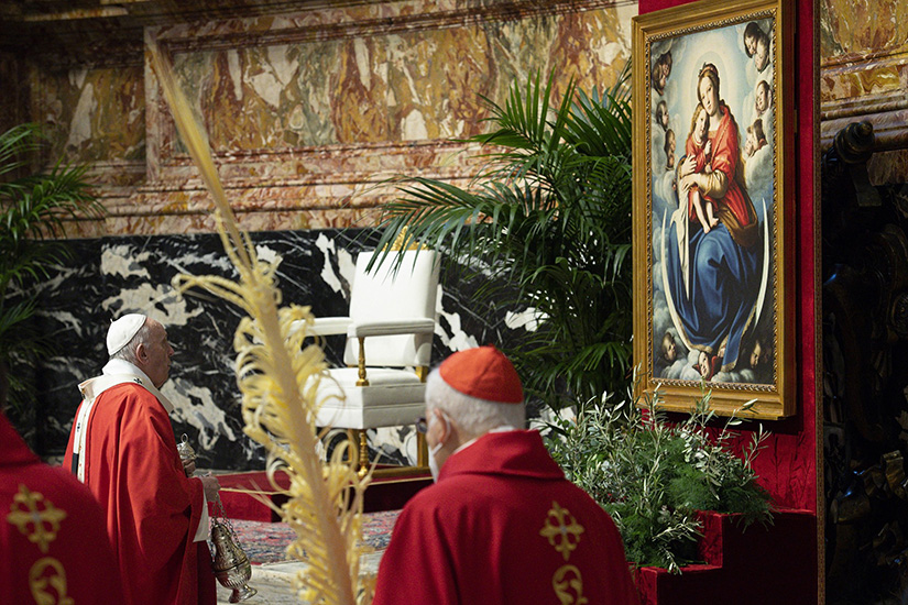 Pope Francis venerated a Marian image during Palm Sunday Mass in St. Peter's Basilica at the Vatican March 28. At his audience March 24, the pope said that Mary occupies a privileged place in the lives of Christians, and therefore, in their prayer as well, because she is the mother of Jesus.