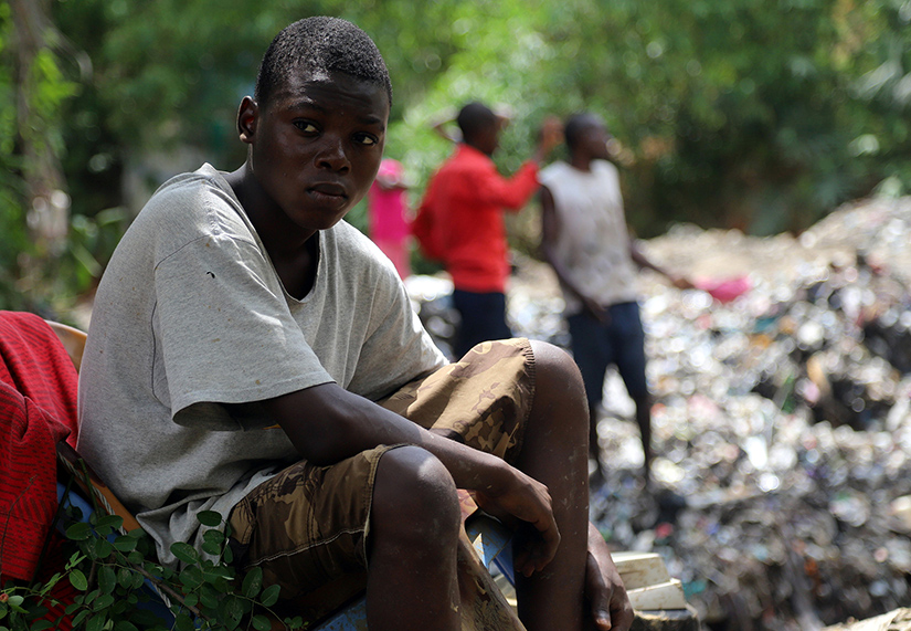 A boy sat near a destroyed house at the scene of a landslide following torrential rains near the University of Kinshasa in Congo in 2019. Many climate scientists have associated an increased number of natural disasters and their severity with climate change.