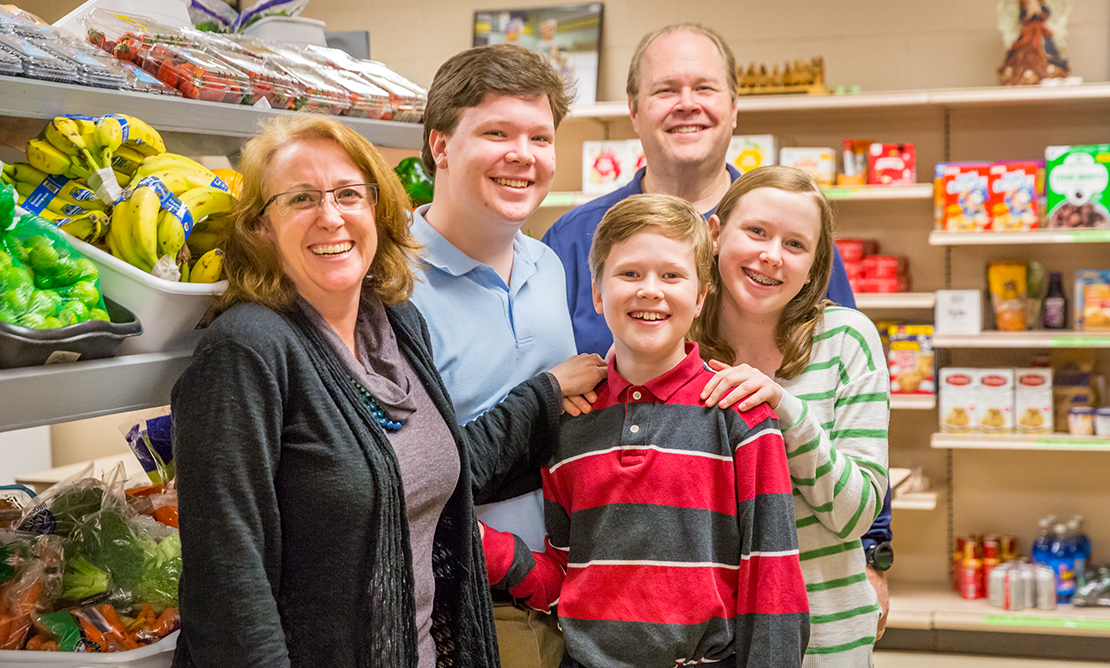 Volunteering at the Affton Christian Food Pantry is among the ways the Meehans, live faith as a family. From left: Jen, James, Patrick, Jim and Megan.
