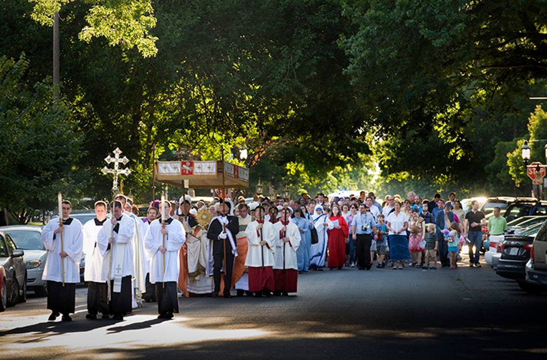 A Corpus Christi procession traveled through the streets of the Central West End to an outdoor altar for benediction.