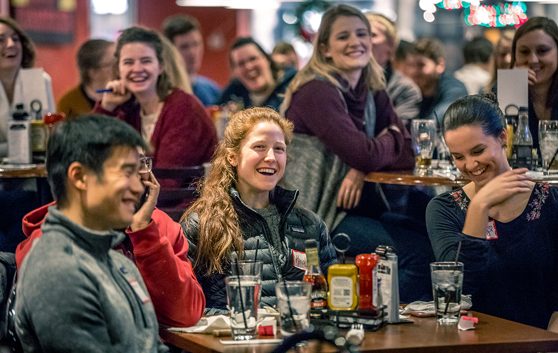 Kristen DeLaune, center, laughed with friends during Father Eddie Voltz's Theology on Tap talk at Kirkwood Station Brewing. Theology on Tap is held monthly, giving young adults a chance to meet, socialize and learn about topics relevant to young adult Catholics.