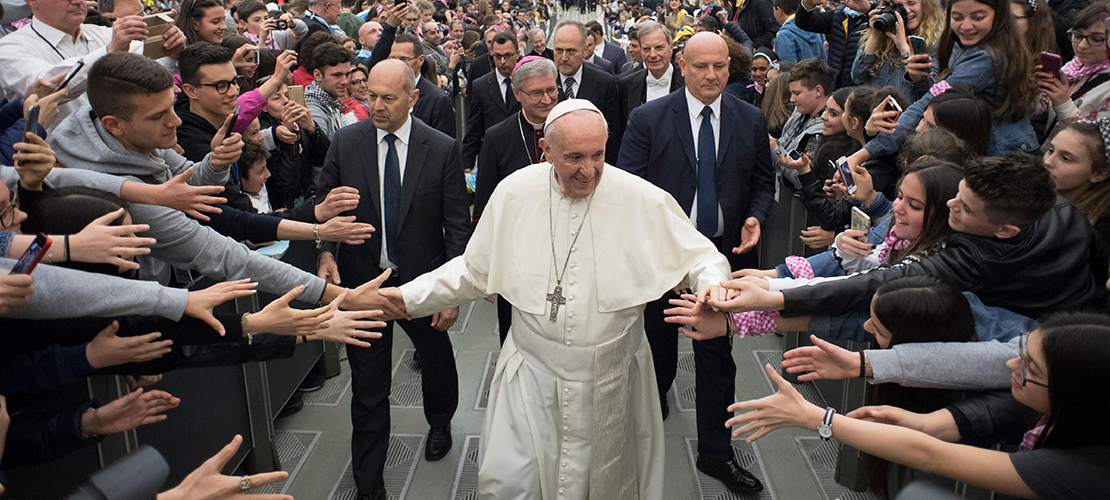 Pope Francis greeted young people as he left an audience with young people from the northern Italian Diocese of Brescia in Paul VI hall at the Vatican April 7.