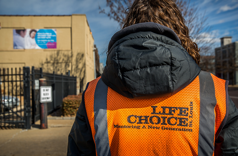 Coalition for Life intern Katie Gossar waits to talk to women as they arrive at Planned Parenthood on March 13. The St. Louis Board of Aldermen rejected a bill that would have created a buffer zone around health care facilities, including Planned Parenthood.