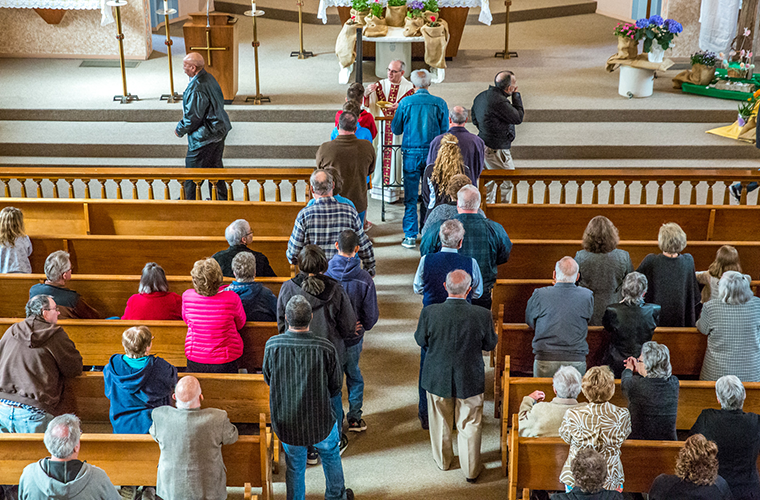 Parishioners at Immaculate Conception in St. Mary received the Eucharist in the church's final Sunday Mass with Bishop Mark Rivituso on April 15.