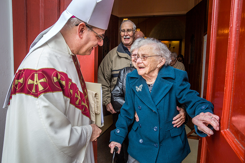 "Bishop Mark S. Rivituso spoke with 94-year-old Bridget Griffard, known as the ""Energizer Bunny"" of the Immaculate Conception in St. Mary, as she exited the church after Mass April 15. Griffard received all her first sacraments at the parish and has until recently cooked the parish's chicken and dumpling meals and belonged to the quilt club."