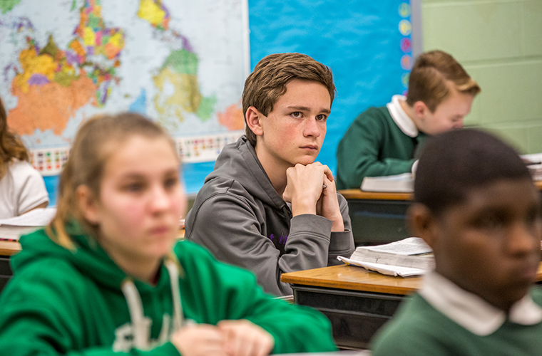 Jackson Cooper, a seventh-grader at Christ the King School in University City, listened to teacher Mike Bettonville in social studies class on April 16. Jackson is the Missouri state winner of the National Geographic Bee and will head to Washington, D.C., to compete with 53 other winners from across the United States.