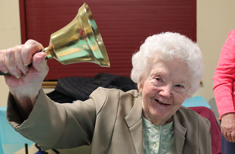 Leona Scharfenberg, 94, donated this century-old school bell back to St. John's-Gildehaus School after keeping it safe in her home for nearly 60 years. From the early 1900s the bell was used by the educators to summon children to recess, meals and prayer before being replaced by an electronic bell in 1961. Shortly after, Sister Aniceta Loeffler gave the bell to Scharfenberg, who was a school cook.