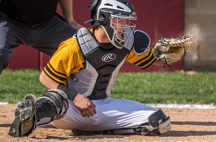 St. John Vianney High School catcher Andrew Keck caught all seven innings pitcher Luke Mann threw in a game against De Smet Jesuit High School. Keck, who entered the Catholic Church at the Easter Vigil this year, is a leader for Vianney's baseball team.