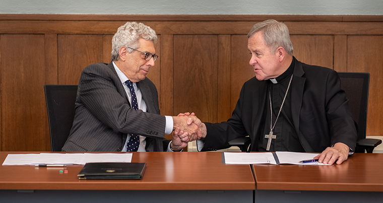 St. Louis University president Fred Pestello, left, and Archbishop Robert J. Carlson signed an agreement that will confer undergraduate degrees from SLU to the graduates of Cardinal Glennon College, although they will still study at Kenrick-Glennon Seminary. The agreement was signed April 23 in the Kenrick Board Room at the Cardinal Rigali Center in Shrewsbury.
