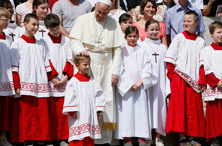 "Pope Francis greeted altar servers at his general audience April 25 in St. Peter's Square at the Vatican. In his talk, the pope said, ""Baptism is not a magic spell but a gift of the Holy Spirit that allows those who receive it to fight against the spirit of evil."""