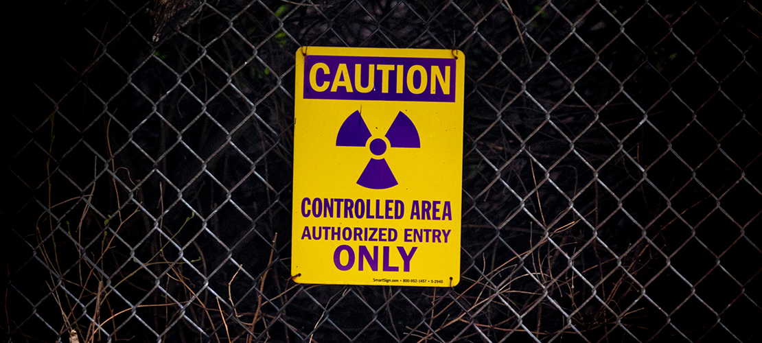 A sign hanging on a chain-link fence at St. Charles Rock Road warns of the radioactive waste contained at West Lake Landfill Superfund Site.