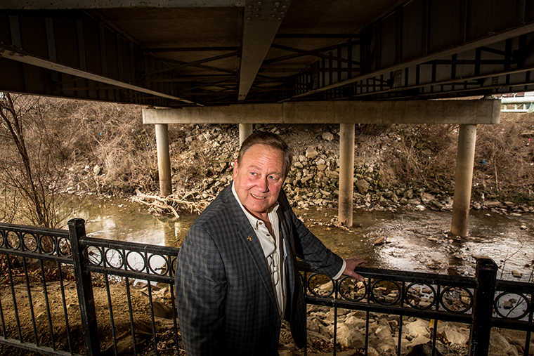 Mark Behlmann is a real estate developer in Florissant and a parishioner at St. Ferdinand. He is pictured along Coldwater Creek in Florissant on March 9. Coldwater Creek ran through the property where he and his wife raised their family. His wife passed away from stage 4 lung cancer eight years ago.