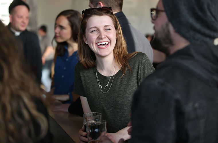 McKaela Laxen, center, talked with Nick Check at a Catholic Beer Club event at Able Seedhouse and Brewery in Minneapolis April 4.