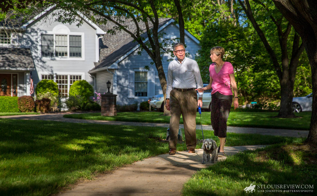 Dr. Dan and Marlene Lischwe walked their dog, Sonny, around their neighborhood on May 7. The couple recently completed St. Louis University's Next Chapter program, a six-month guided journey to help retirees and soon-to-be retirees discern their futures in the Ignatian Tradition.