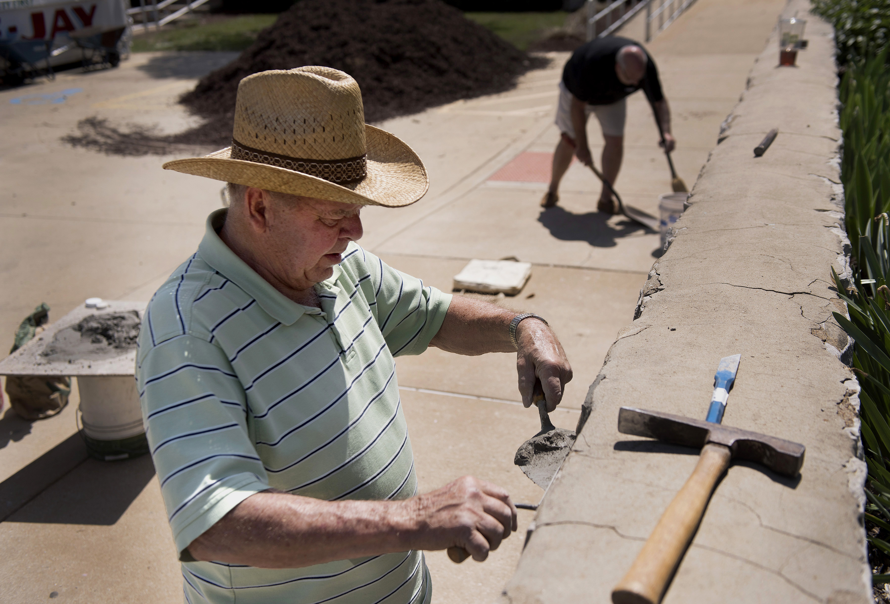 Tom Van Mirelo joined other parishioners from St. Justin Martyr Parish in tuckpointing a wall outside the school as part of the parish's day of service. The service day included preparing meals for the homebound and homeless, making blankets for those in need and performing home repair and lawn care for area residents.