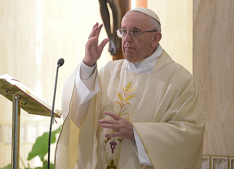 Pope Francis blessed the faithful as he celebrated Mass in the chapel of the Domus Sanctae Marthae at the Vatican May 8. In the homily, the pope cautioned people to stay away from the devil, likening him to an angry, rabid dog that is chained up.