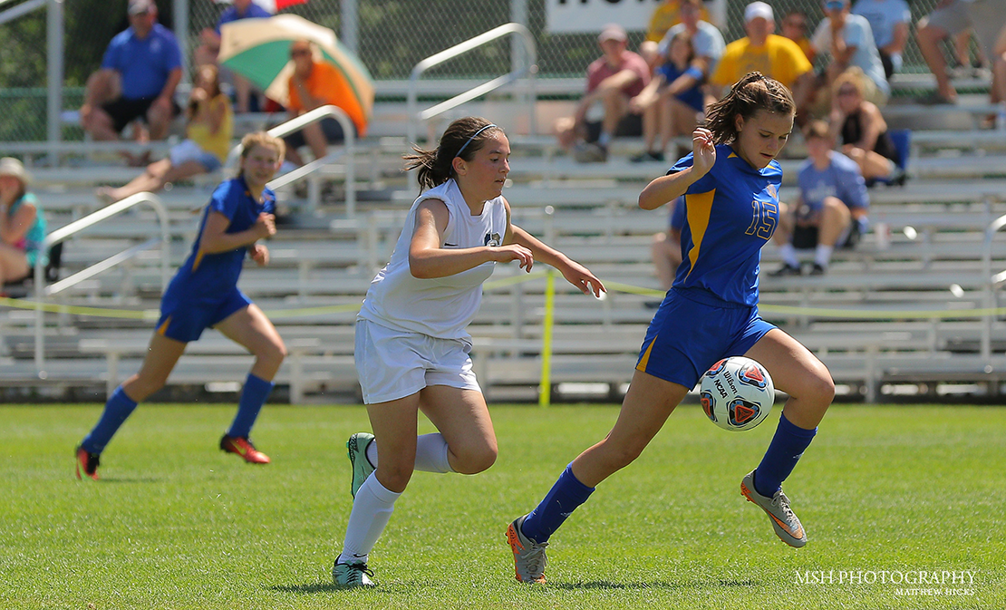 St. Vincent High School's Genevieve Lipe moved the ball down the field against Principia in the MSHSAA Class 1 Girls Soccer Championship May 31 at Swope Village in Kansas City, Mo. Lipe scored a goal in her team's 2-0 victory, the second consecutive soccer title for St. Vincent.