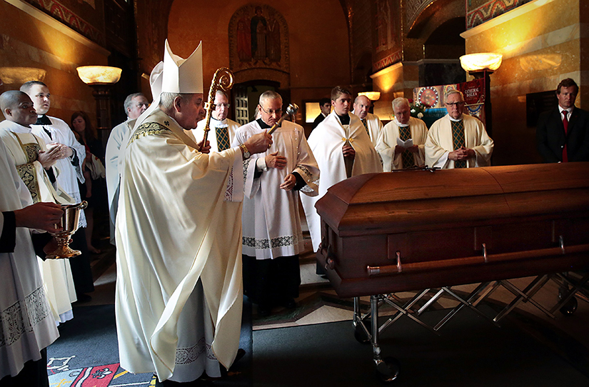 "Archbishop Robert J. Carlson sprinkled holy water on the casket of Albert ""Red"" Schoendienst as a reminder of his baptism as the funeral concludes at the Cathedral Basilica of Saint Louis on June 15. The former Cardinals player, manager and coach died June 6."