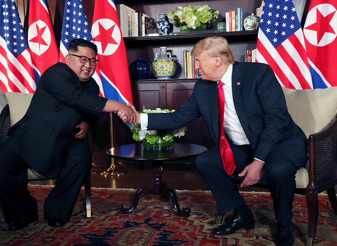North Korea's leader Kim Jong Un shook hands with U.S. President Donald Trump before their bilateral meeting on Sentosa island in Singapore June 12. Signing a joint statement, President Trump agreed to provide security guarantees to North Korea and Chairman Kim reaffirmed his commitment to the complete denuclearization of the Korean Peninsula.